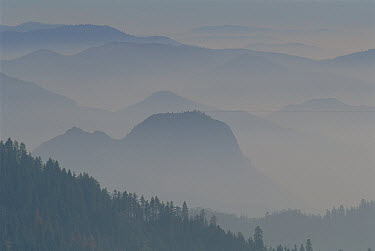 Hazy view to the west across the Sierra Nevada foothills from Kings Canyon National Park, California  -  Jim Brandenburg