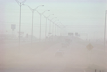 Highway and traffic obscured by dust storm, Lubbock, Texas  -  Jim Brandenburg