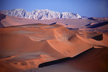 Sand dunes and mountains, Namib Desert, Namibia  -  Jim Brandenburg
