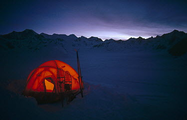 Tent with skis and snowshoes on Ruth Glacier, Denali National Park and Preserve, Alaska  -  Michio Hoshino