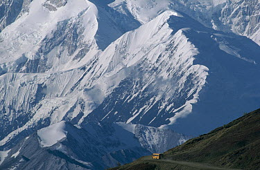 Tour bus driving along dirt road, Denali National Park and Preserve, Alaska  -  Michio Hoshino