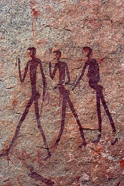 Cave art depicting hunters, Namibia  -  Jim Brandenburg