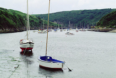 Sailboats floating during high tide, Wales, United Kingdom  -  Jim Brandenburg