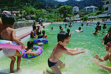 Tourists from cities come to Tam Dao for weekends and holidays, children playing in pool near the border of Tam Dao National Park, Vietnam  -  Mark Moffett