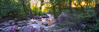 Purple rock is catlinite or pipestone used by Native Americans to make the peace pipe, Pipestone Creek, Pipestone National Monument, Minnesota  -  Jim Brandenburg