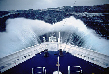 Cruise ship in storm, Antarctica  -  Mitsuaki Iwago