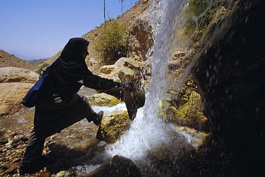 Herpetologist Soheila Shafii cools off under a waterfall, Seyed Ali, Iran  -  Mark Moffett