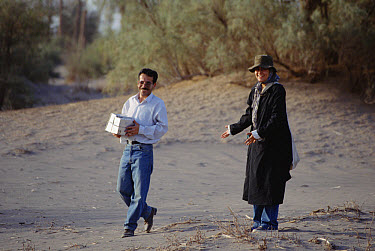 Sheda with Mohammed Nassen, both smiling because they captured four live rodents in traps, Shadad, Iran  -  Mark Moffett