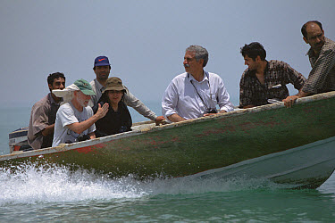 Jim Patton and Sheda with Iranian mammologist Houshang Ziaie in boat on way to mangrove swamps, Hara protected area, Iran  -  Mark Moffett
