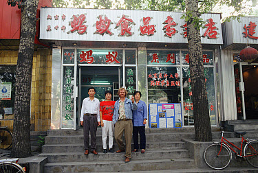 Photographer, Mark Moffett with cup of ant tea, outside ant medicinal shop, Beijing  -  Mark Moffett
