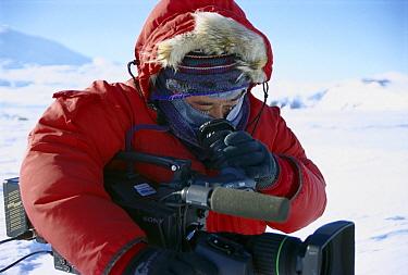Photographer Norbert Wu at work in Antarctica  -  Norbert Wu