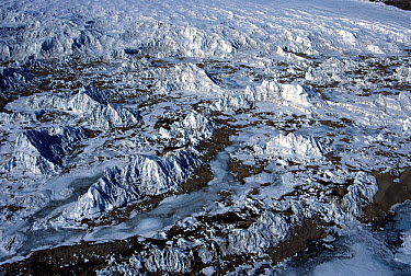 Aerial view of windswept ice formations at the base of a glacier in the McMurdo dry valleys, Victoria Land, Antarctica  -  Norbert Wu