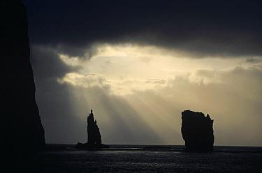 Silhouetted cliffs with stormy skies, North Coast, Eysturoy, Faroe Islands  -  Tui De Roy