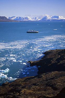 Tour ship Polaris and brash ice under evening light, Kross Fjord, Svalbard Archipelago, Norway  -  Tui De Roy