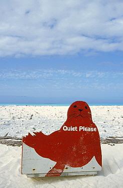 Hawaiian Monk Seal (Monachus schauinslandi) shaped sign reads 'Quiet please, Monk Seal breeding grounds', Midway Atoll, Hawaii  -  Tui De Roy