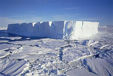 Tabular iceberg with broken fast ice, Prince Olav Coast, East Antarctica  -  Tui De Roy