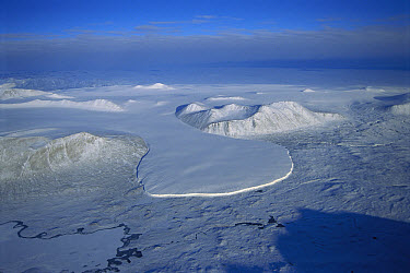Taylor dry valley with small glacier spilling into the sea, Asgard Range, Ross Sea, Antarctica  -  Tui De Roy