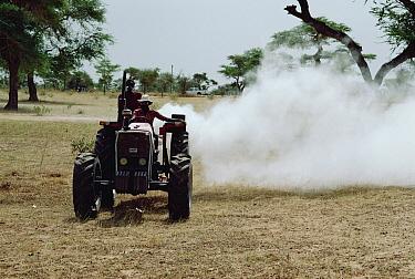 Farmer spraying for Locust, South Africa  -  Mitsuhiko Imamori