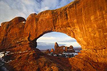 Turret arch through north window arch, Arches National Park, Utah  -  Tim Fitzharris