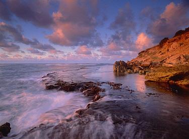 Dawn from the base of Makewehi Cliffs near Shipwreck Beach, Keoneloa Bay, Kauai, Hawaii  -  Tim Fitzharris