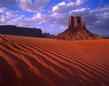 East and West Mittens, buttes with rippled sand, Monument Valley, Arizona  -  Tim Fitzharris
