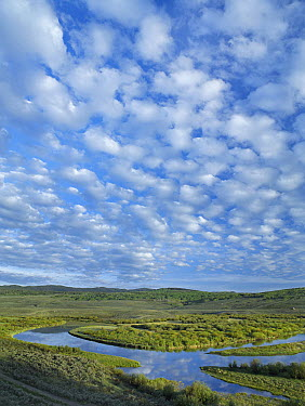 Cloudy skies over the Green River, Bridger-Teton National Forest, Wyoming  -  Tim Fitzharris