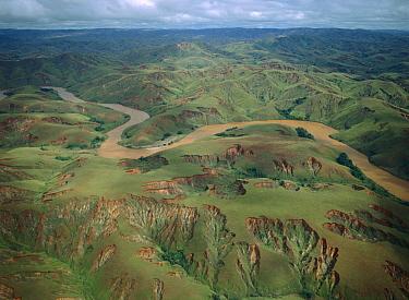 Deforested and deeply eroded hills alongside silted river, Betsiboka River, Madagascar  -  Konrad Wothe