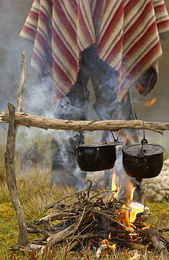Chagra cowboys with cooking in camp at a hacienda during the annual overnight cattle round-up, Andes Mountains, Ecuador  -  Pete Oxford