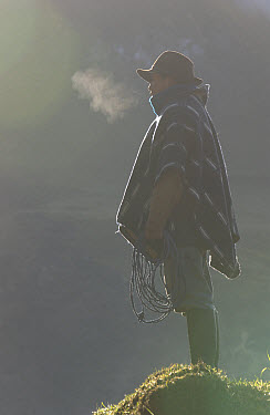 Chagra cowboy in the morning at a hacienda in the Andes Mountains, Ecuador  -  Pete Oxford