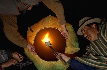 Chagra cowboys lighting a balloon at a hacienda to celebrate a successful rodeo, Andes Mountains, Ecuador  -  Pete Oxford