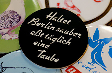 Sticker from the German pigeon museum in Nuernberg with the words, keep Berlin clean, everyday eat a pigeon  -  Heidi & Hans-Juergen Koch