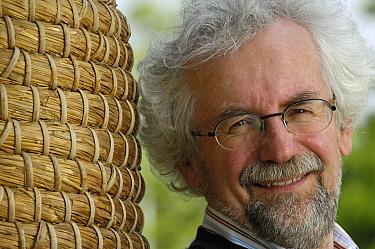 Professor Dr. Jurgen Tautz, teacher of biology at the Bavarian Julius-Maximilians-University of Wurzburg, Germany, head of the Bee group, portrait with a beehive  -  Heidi & Hans-Juergen Koch
