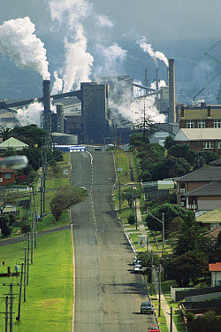 Air pollution spewing from smokestacks at BHP Steelworks adjacent to housing, Port Kembla, New South Wales, South Australia  -  Reg Morrison/ Auscape
