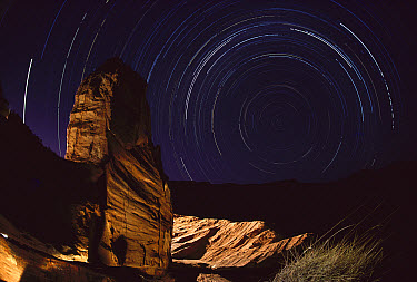 Shatter cone structure in rocks, evidence of 130 million year old cosmic impact, south polar star trails in background, Gosses Bluff, Tnorala Conservation Reserve, Northern Territory, Australia  -  Reg Morrison/ Auscape