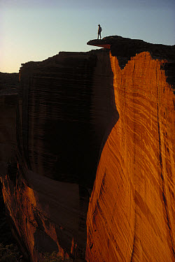 Person standing atop the Kings Canyon north wall, Watarrka National Park, Northern Territory, Australia  -  Jean-Paul Ferrero/ Auscape