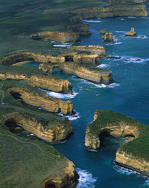 Port Campbell National Park with Mutton bird Island in foreground, the Island Archway and Twelve Apostles beyond, Victoria, Australia  -  Jean-Paul Ferrero/ Auscape