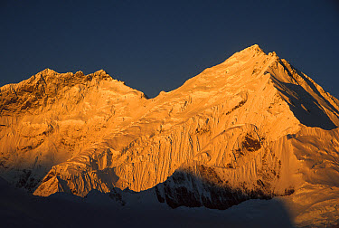 Dawn light on Mt Lhotse (Left) the South Col of Mt Everest (Center) and the Kangshung face of Mt Everest as seen from 6,200 meters elevation at Kharta Glacier, Tibet  -  Colin Monteath/ Hedgehog House