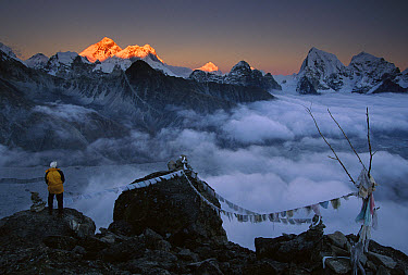 Mountaineer enjoying the view of Mt Everest and the Himalayan Mountains at sunset from Gokyo Ri, Khumbu, Nepal  -  Colin Monteath/ Hedgehog House