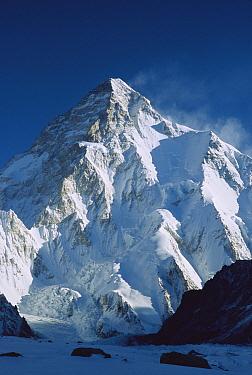 K2 at dawn at 8,611 meters is the second highest peak in the world, seen from camp below Broad Peak, Godwin Austen Glacier, Karakoram Mountains, Pakistan  -  Colin Monteath/ Hedgehog House