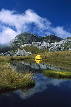 Campsite on tarn amongst limestone formations on Mt Owen, Kahurangi National Park, New Zealand  -  Colin Monteath/ Hedgehog House