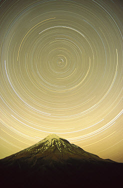 Star trails around the south celestial pole in the evening sky over the Pouakai Range, Egmont National Park, New Zealand  -  Harley Betts/ Hedgehog House