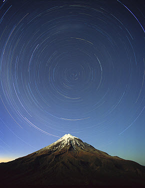 Star trails around the south celestial pole over Mt Taranaki, also known as Mt Egmont (8,261 feet) a dormant volcano in the southwest corner of the North Island near the Tasman Sea, Egmont National Pa...  -  Harley Betts/ Hedgehog House