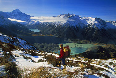 Mueller Glacier Terminal Lake, hiker in snow looking at Mt Cook or Aoraki, Mt Cook National Park, New Zealand  -  Colin Monteath/ Hedgehog House