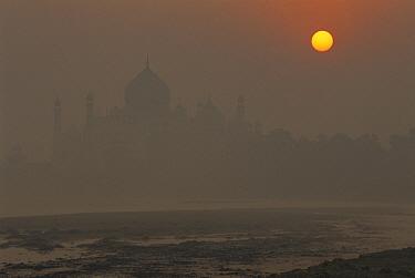 Taj Mahal, dawn beside Jumna River showing air pollution, Agra, India  -  Colin Monteath/ Hedgehog House