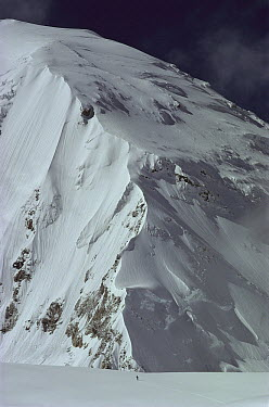 Skier on central Rongbuk Glacier, underneath the west ridge of Mount Everest during an ascent of the north face, Tibet  -  Colin Monteath/ Hedgehog House