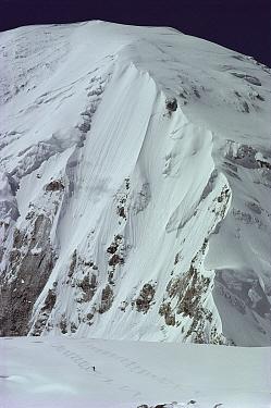 Skier descends Central Rongbuk Glacier with Mount Everest in the background, Tibet  -  Colin Monteath/ Hedgehog House