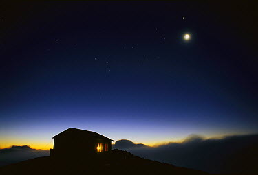 Moon and stars over hut, Egmont National Park, New Zealand  -  Guy Vickers/ Hedgehog House