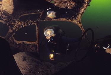 Scuba diver examining car underwater, Red Sea, Egypt  -  Hans Leijnse/ NiS