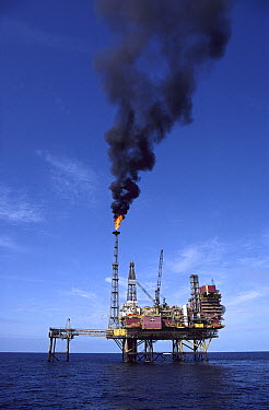 Oil rig in the ocean with smokestack, North Sea  -  Martin Smith/ FLPA