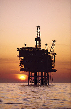 Oil rig in the ocean at sunset, North Sea  -  Martin Smith/ FLPA
